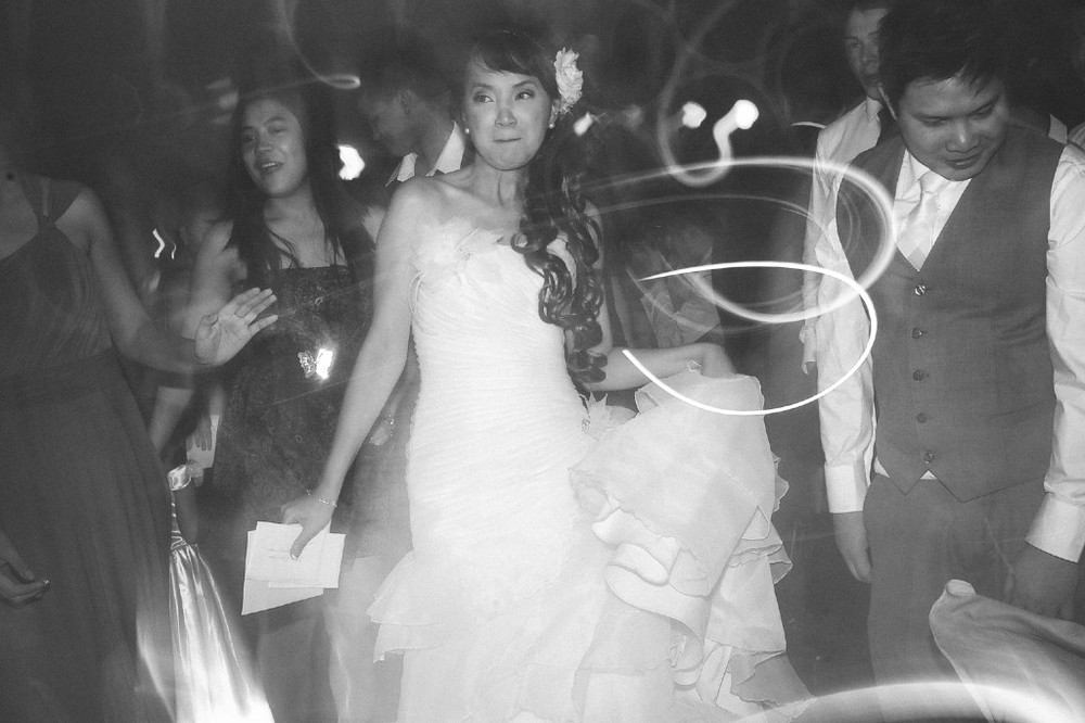 san   diego wedding photographer | monotone shot of bride dancing in middle of   crowd