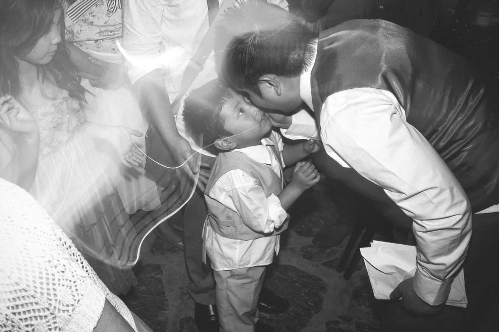 san   diego wedding photographer | monotone shot of groom talking close with   child
