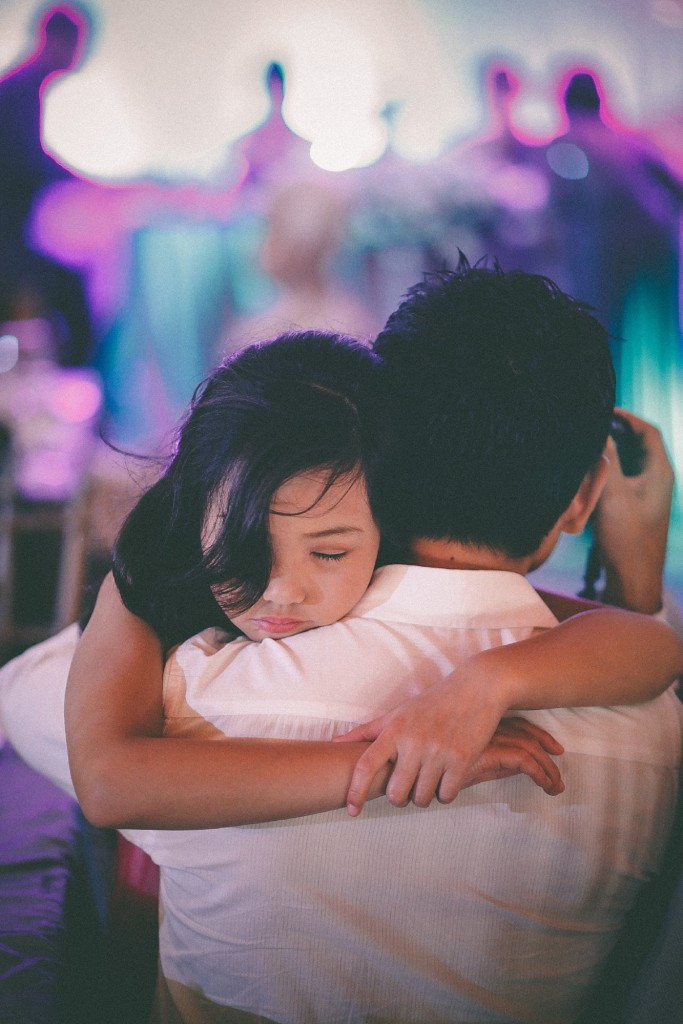 san   diego wedding photographer | child falling asleep while her arms are around   man in white shirt's neck