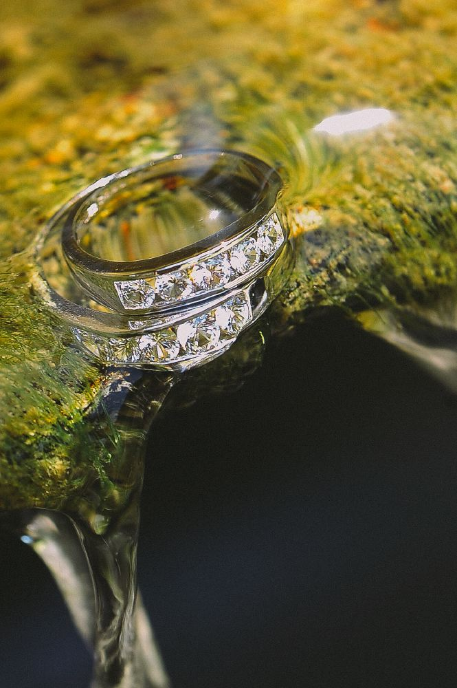 san   diego wedding photographer   ring half submerged in clear water
