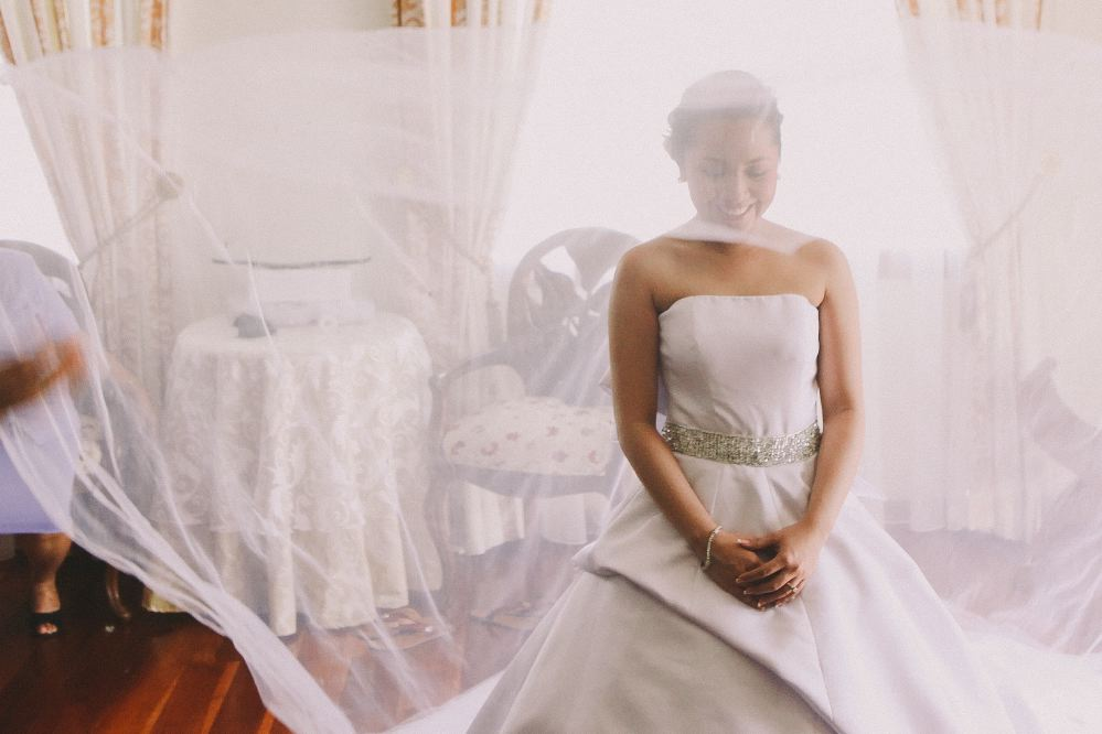 san   diego wedding photographer | woman smiling being slightly covered by thin   cloth