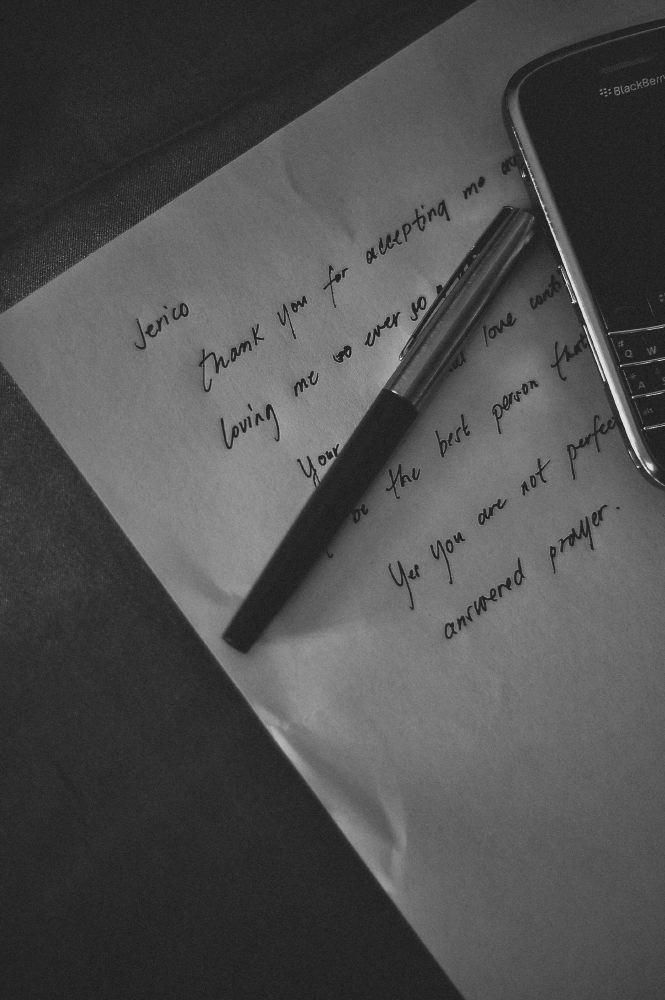 san   diego wedding photographer | closeup shot of handwritten letter with keypad   phone