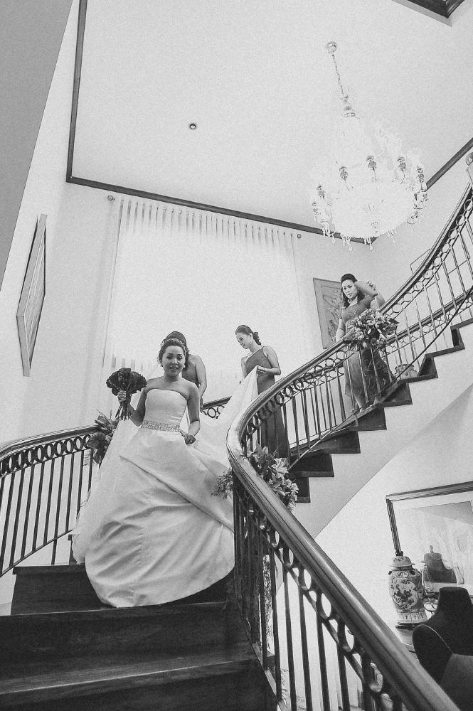san   diego wedding photographer   monotone shot of woman walking down spiral   staircase