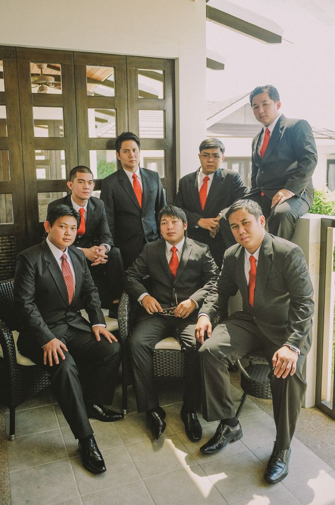 san   diego wedding photographer   men in black suits and red neckties posing   looking at camera