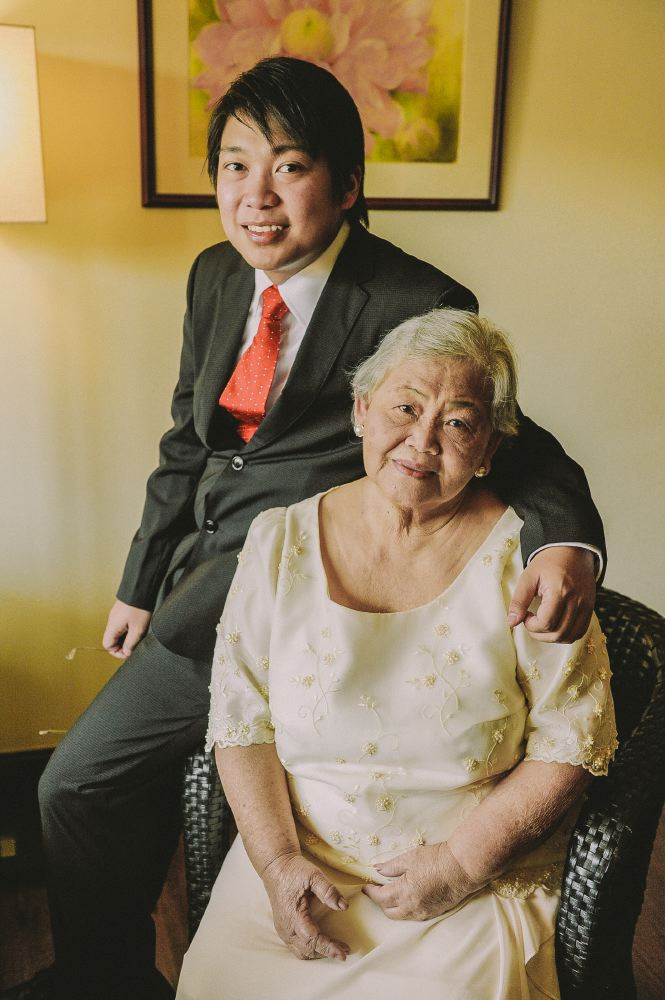 san   diego wedding photographer   man posing with arm around older woman in   traditional dress