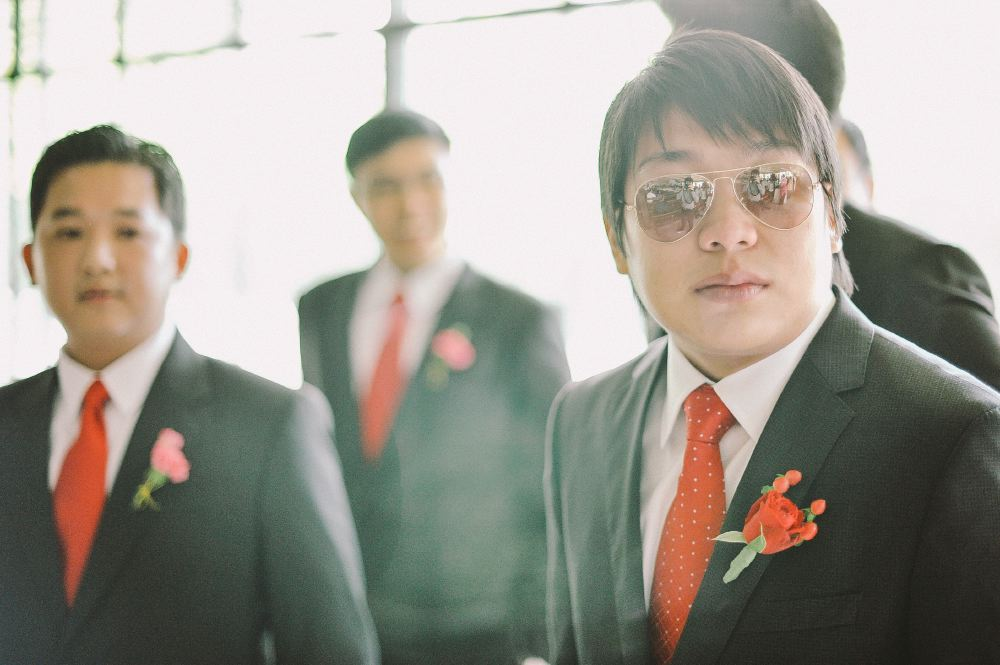 san   diego wedding photographer   man in aviators standing with men in black suits   and red neckties