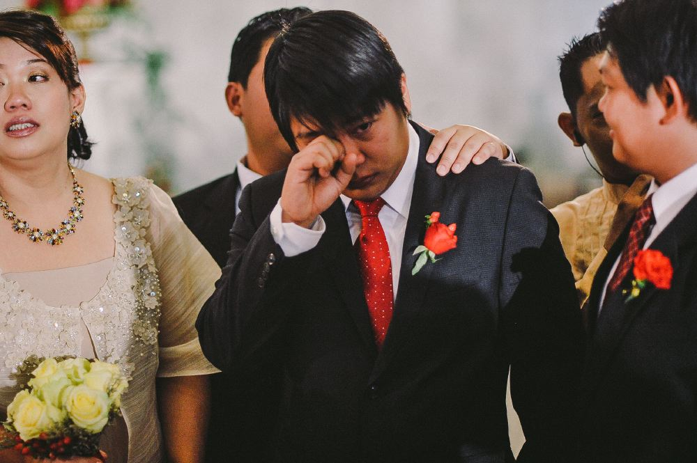 san   diego wedding photographer   teary eyed man in suit and red tie