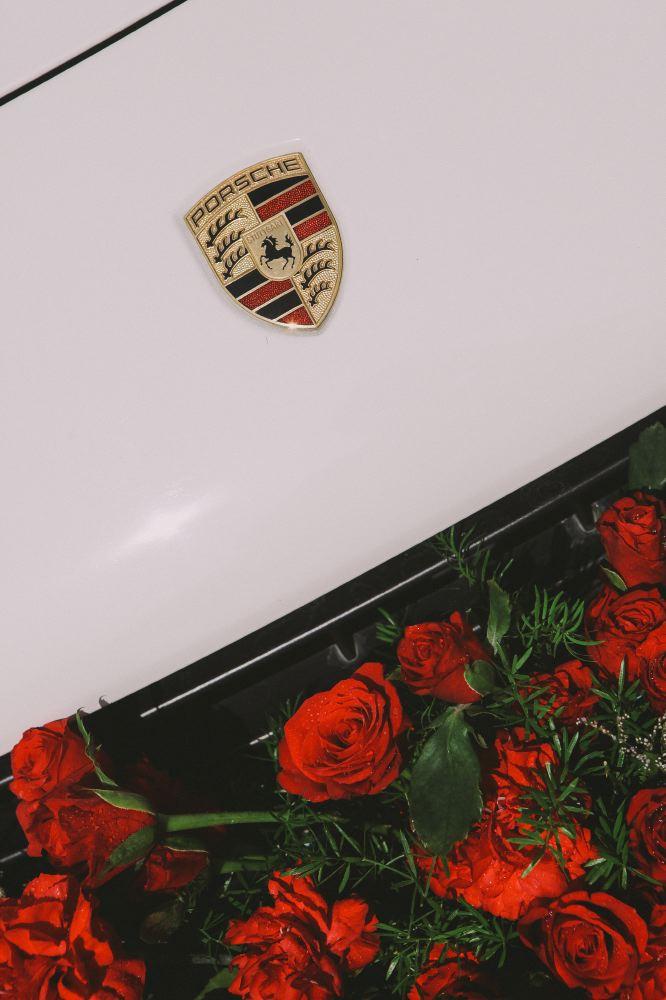 san   diego wedding photographer   closeup of porsche hood with roses