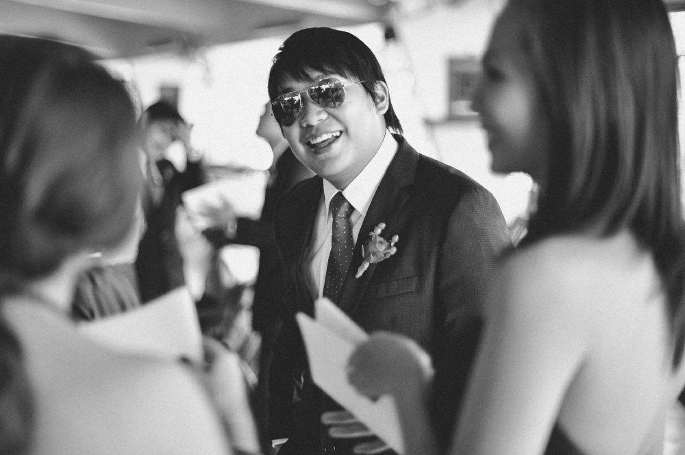 san   diego wedding photographer   monotone shot of man in aviators greeting women