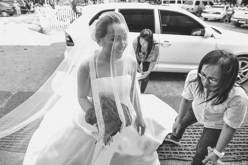 san   diego wedding photographer   monotone shot of woman stepping out into front   of chapel