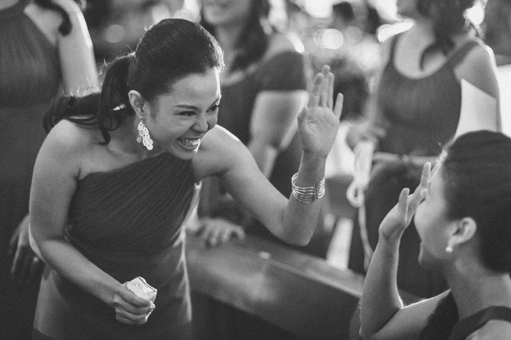 san   diego wedding photographer   monotone shot of bridesmaids about to highfive