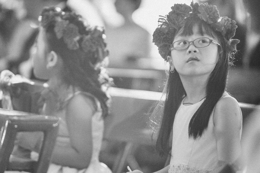 san   diego wedding photographer   little girls with flower crowns sitting on   church pews