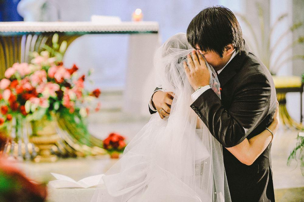 san   diego wedding photographer | groom hugging bride covered in veil