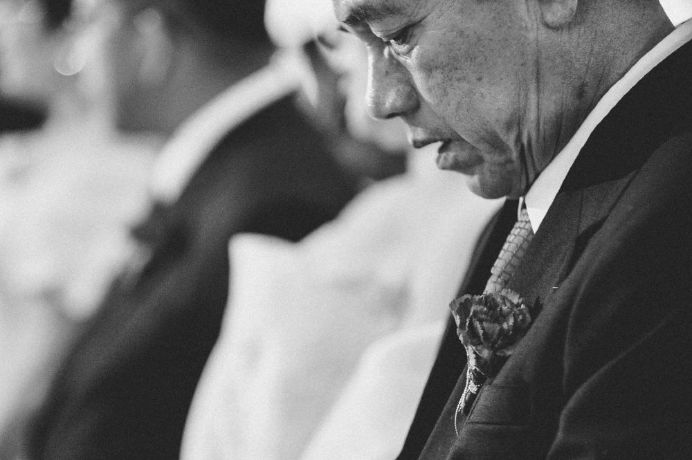 san   diego wedding photographer | monotone shot of old man sitting on church pew