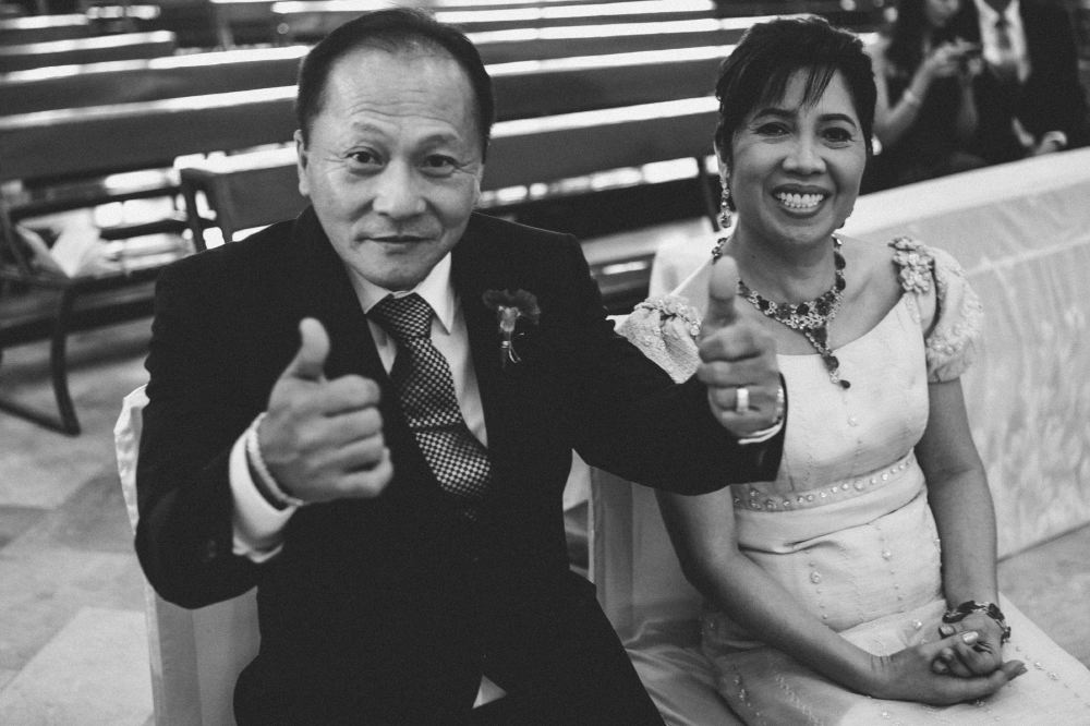 san   diego wedding photographer   monotone shot of middle aged man with thumbs up   sitting beside woman