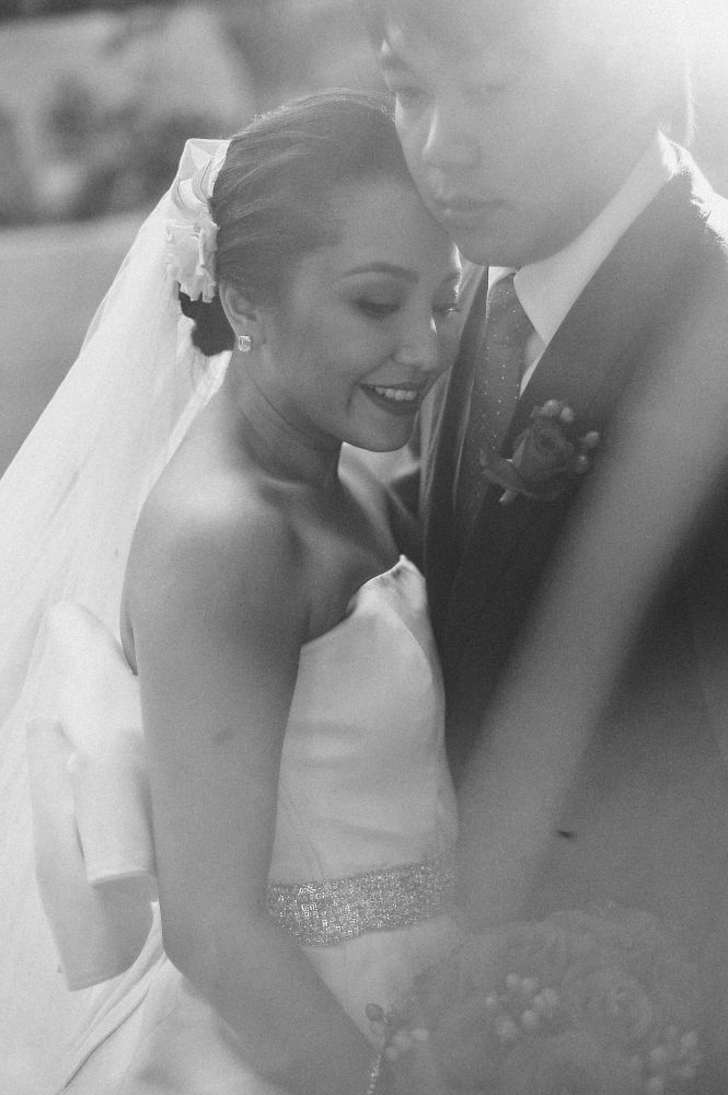 san   diego wedding photographer   monotone shot of bride and groom dancing close   while bride hold bouquet