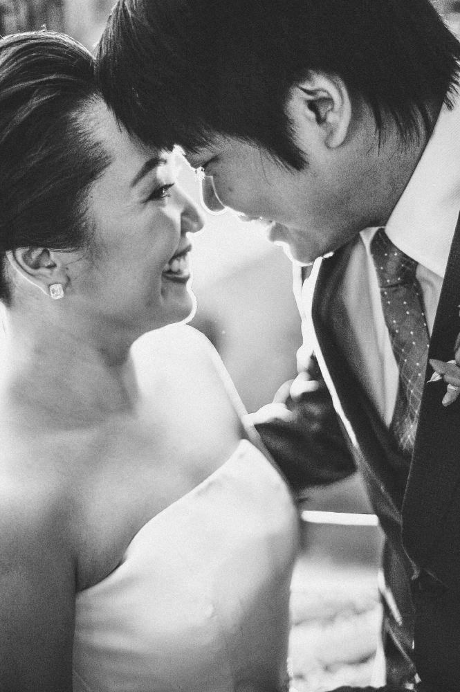 san   diego wedding photographer   monotone shot of bride and groom's face close to   each other smiling laughing