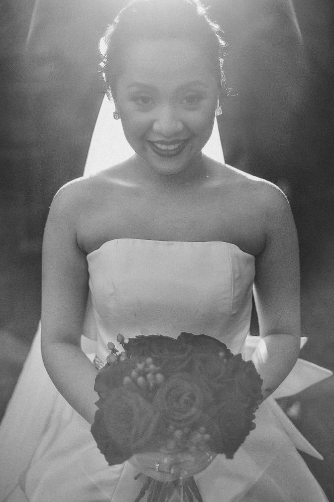 san   diego wedding photographer   monotone shot of bride holding bouquet of   flowers standing