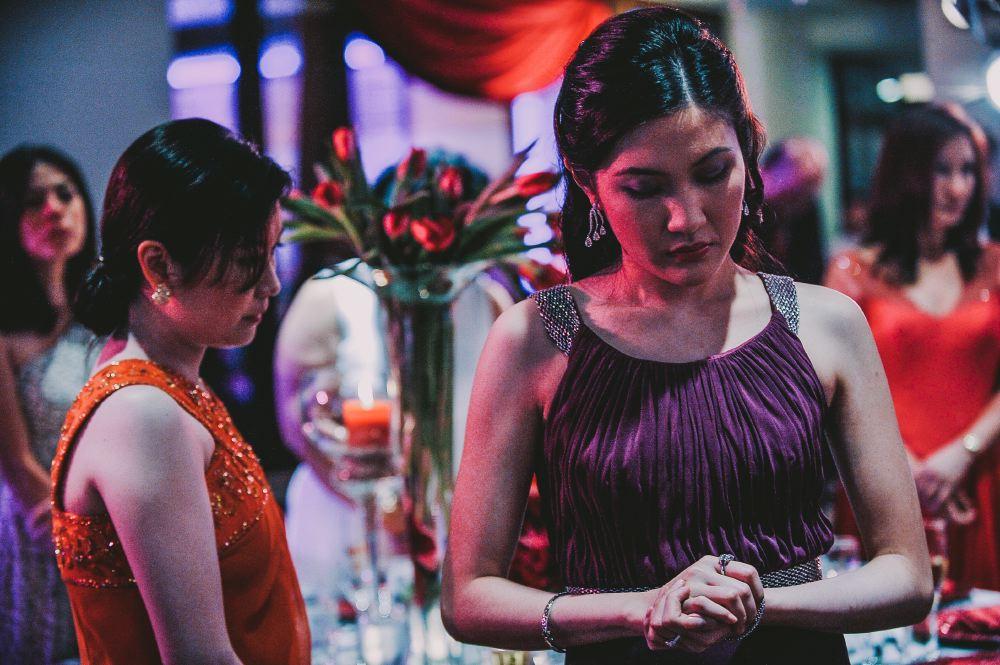 san   diego wedding photographer   woman standing around table with flower   arrangement
