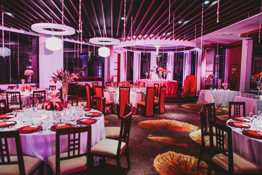 san   diego wedding photographer   shot of reception area lit by pink lights