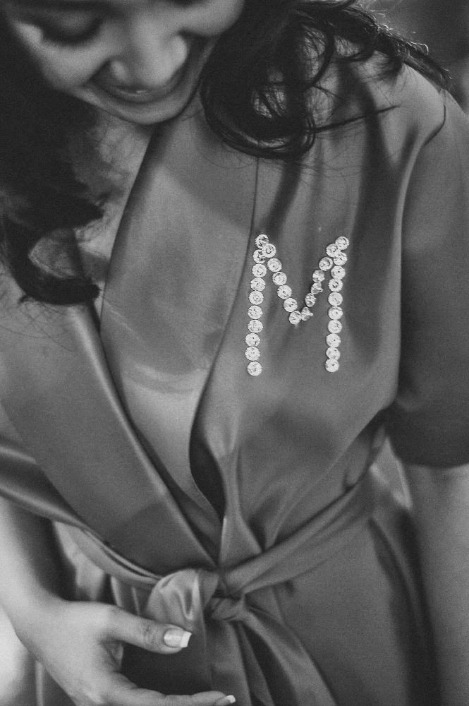 san   diego wedding photographer   monotone shot of bride with robe engraved with   the letter M in bedazzles