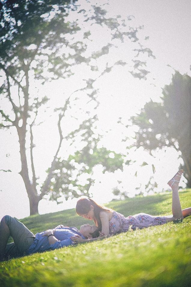 san   diego wedding photographer | man lying down on his back with woman lying on   her front