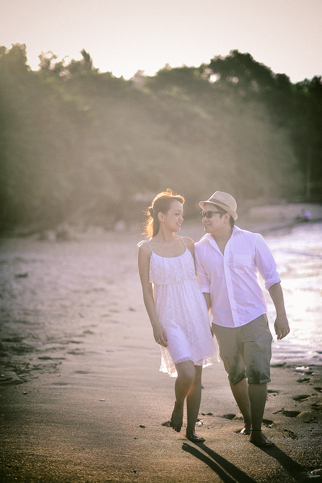 san   diego wedding photographer | man and woman in white walking along beach shore