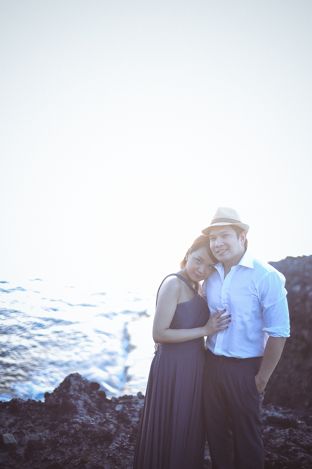 san   diego wedding photographer | woman in dress and man in fedora posing on top   of rocky shore