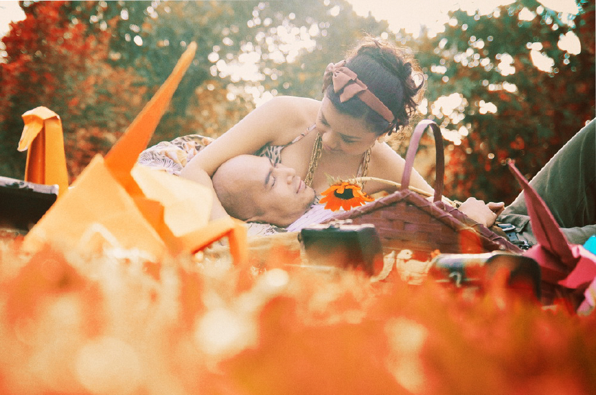 san   diego wedding photographer | man lying on the grass with woman in bow