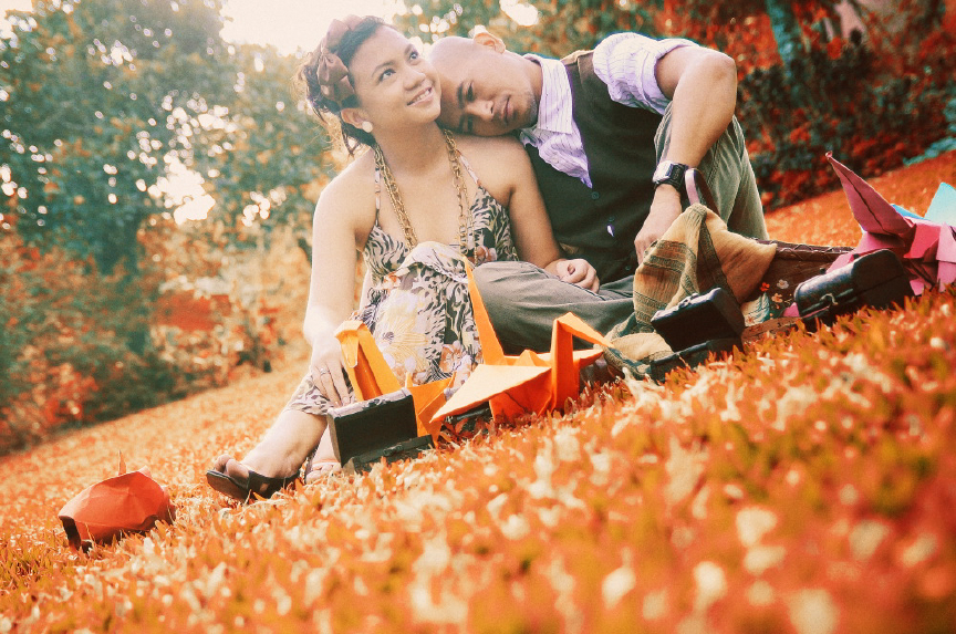 san   diego wedding photographer | couple sitting on grass with paper cranes aroung   them
