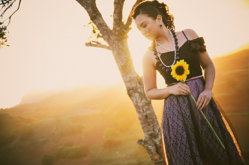san   diego wedding photographer | woman in black top posing in front of tree with   sunflower