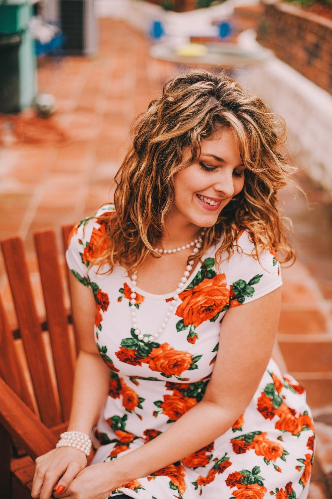 san   diego wedding photographer | woman with highlights in white floral dress and   pearls sitting