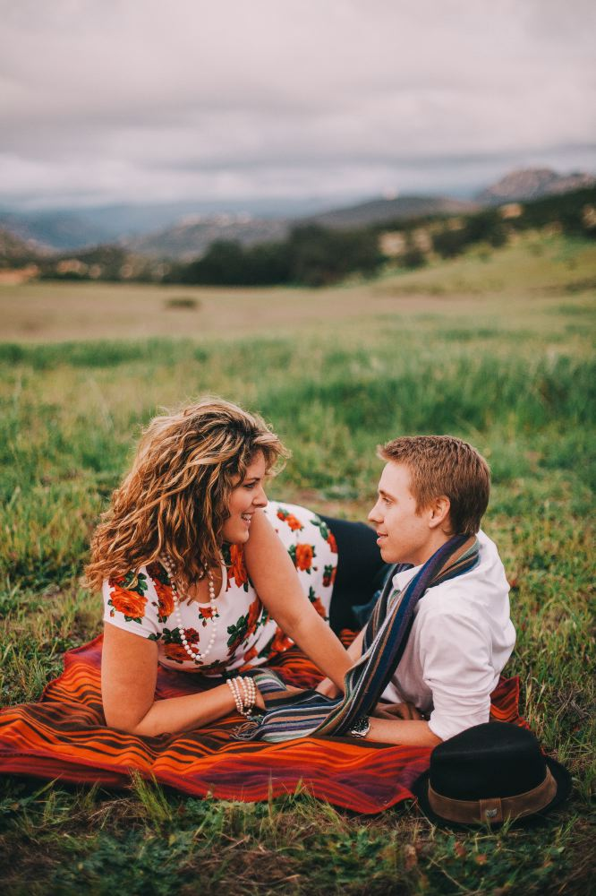 san   diego wedding photographer | man and woman laying on blanket on ground