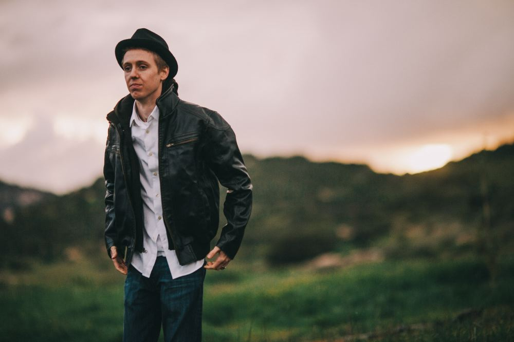 san   diego wedding photographer | man in leather jacket with sunset in background