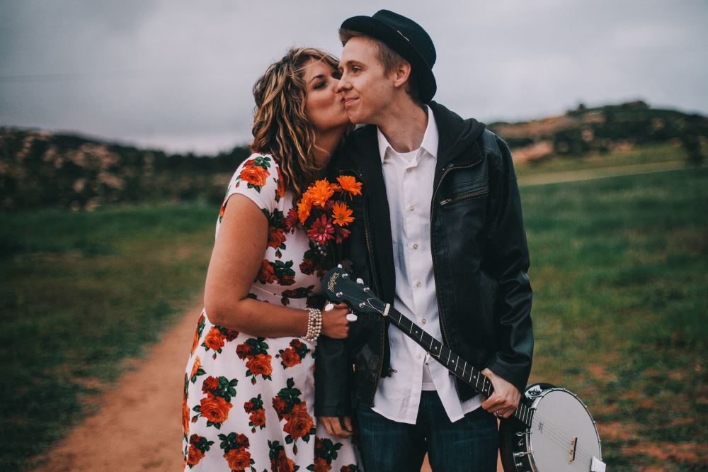 san   diego wedding photographer | man in leather jacket holding banjo with woman   holding bunch of flowers