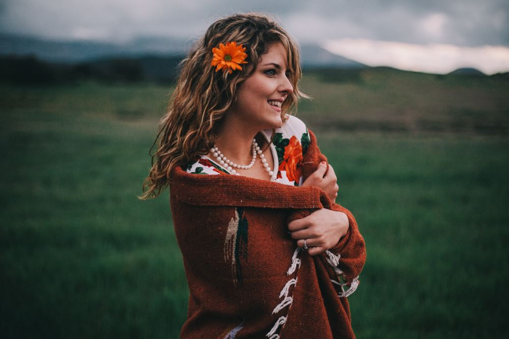 san   diego wedding photographer | woman with orange flower in hair with blanket   wrapped around her