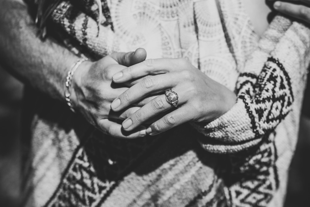 san   diego wedding photographer | monotone shot of woman's hand wearing engagement   ring over man's hand wearing bracelet