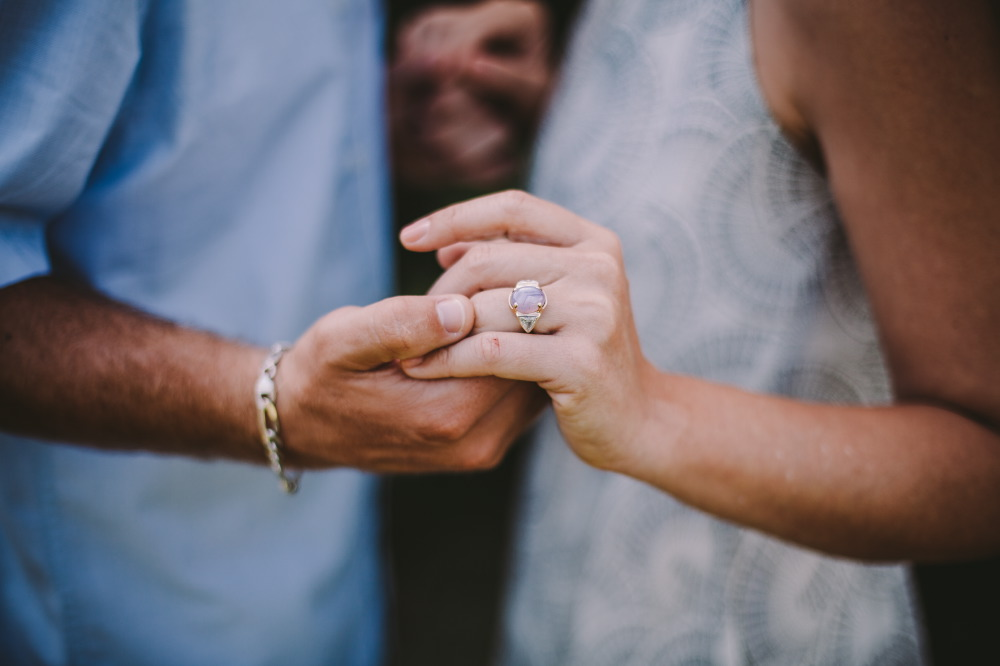 san   diego wedding photographer | woman's hand wearing engagement ring holding   man's hand wearing bracelet