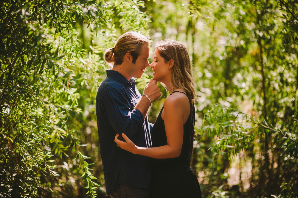 san   diego wedding photographer | blonde man in ponytail holding chin of blonde   woman with closed eyes