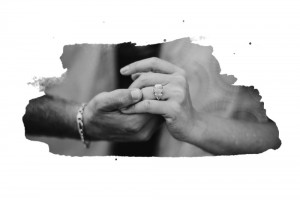 san   diego wedding photographer | monotone shot of woman's hand wearing engagement   ring over man's hand wearing bracelet with frame edit