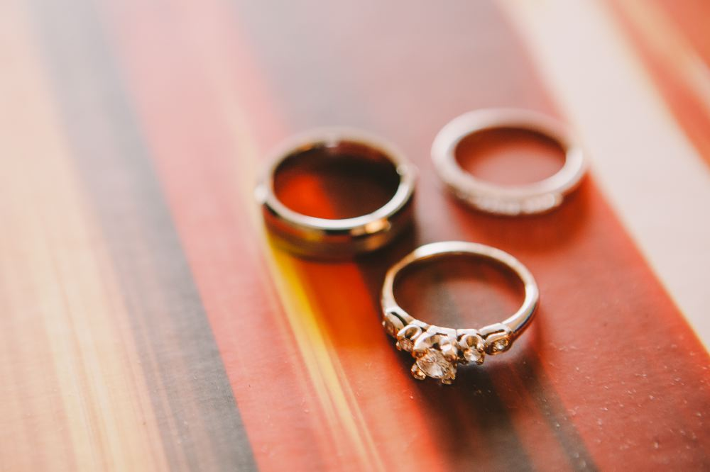 san   diego wedding photographer | 3 rings on a wooden table