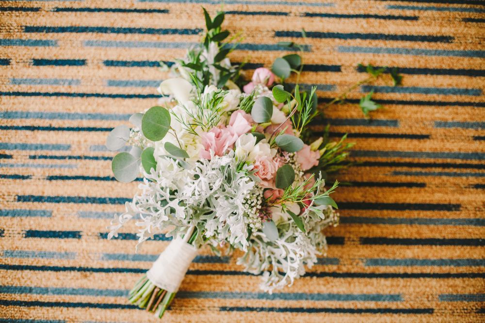 san   diego wedding photographer | bouquet with light pastel colors on rug