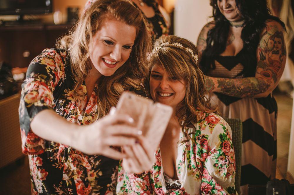 san   diego wedding photographer | women in floral kimonos taking a selfie