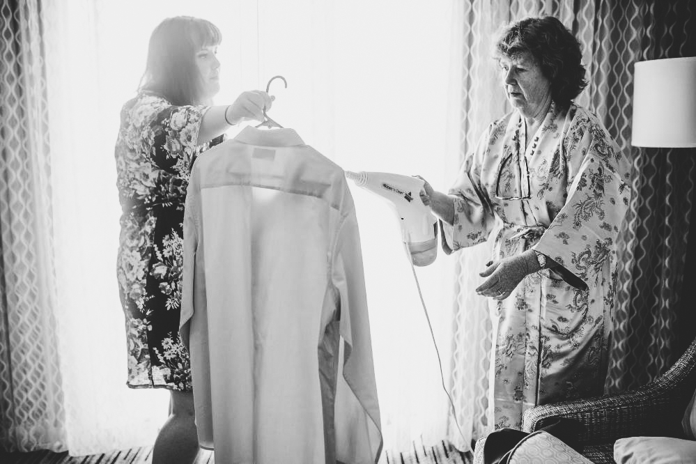 san   diego wedding photographer | monotone shot of women in kimonos handling a   shirt