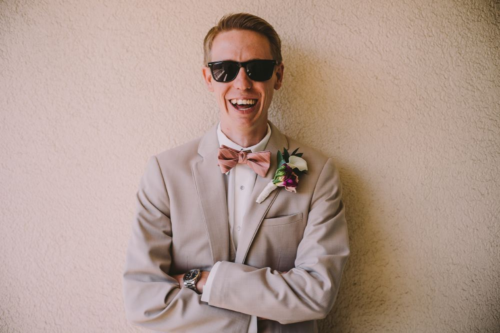 san   diego wedding photographer | man in pink bow tie smiling at camera