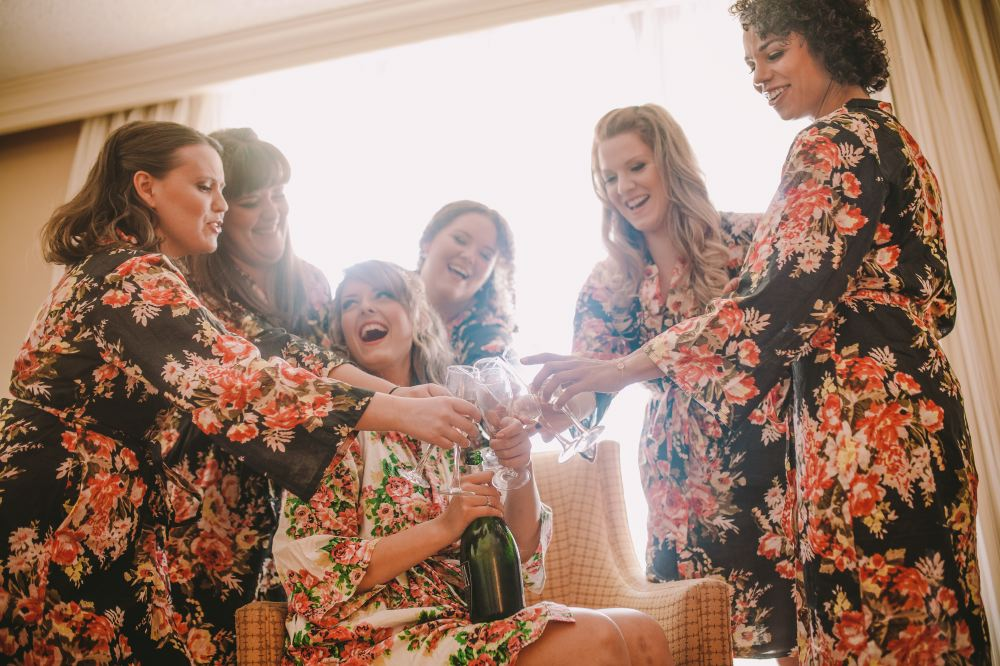 san   diego wedding photographer | group of women in floral kimonos making a toast   with glasses
