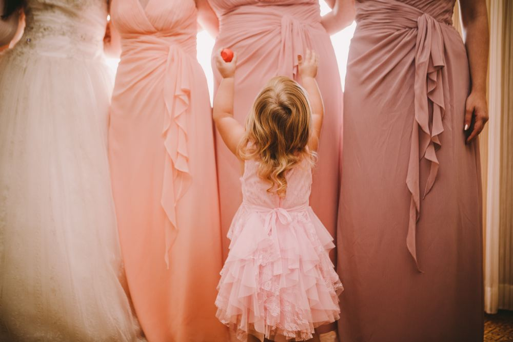san   diego wedding photographer | child reading up to women in pink dresses