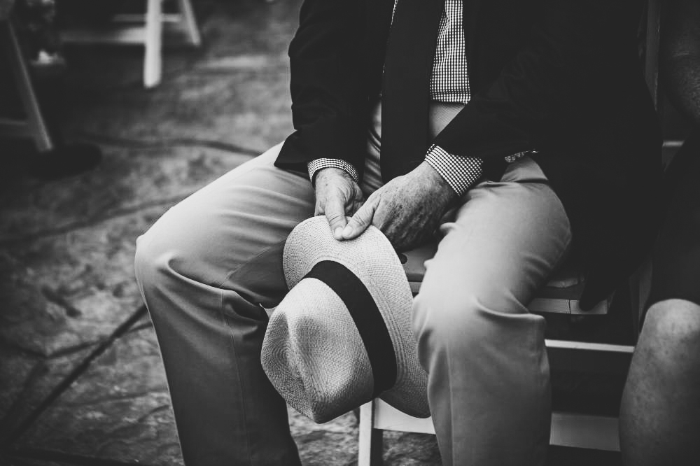 san   diego wedding photographer | monotone shot of man's lower body holding   hat