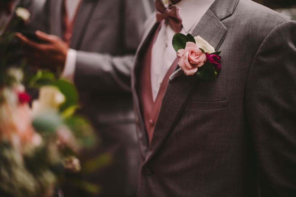 san   diego wedding photographer | man's torso in grey suit and buttonniere