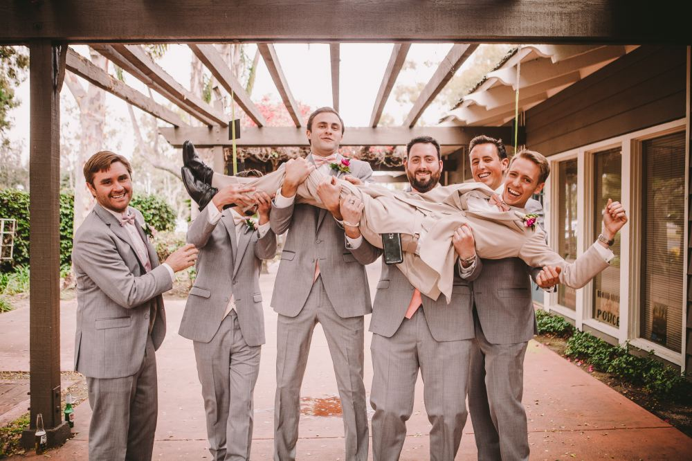 san   diego wedding photographer | groomsmen lined up carrying groom